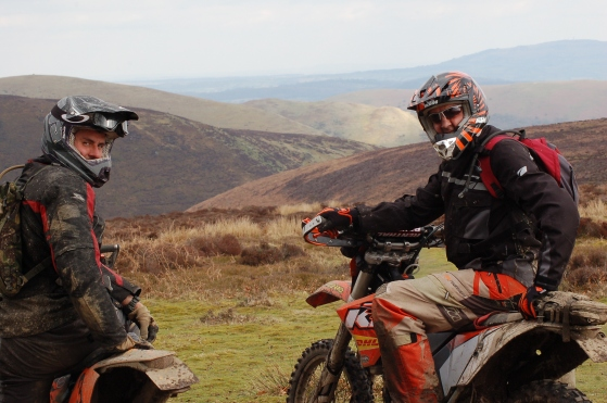 Alex and Tim enjoy a quick break and take in the beauty of the view east across the Long Mynd