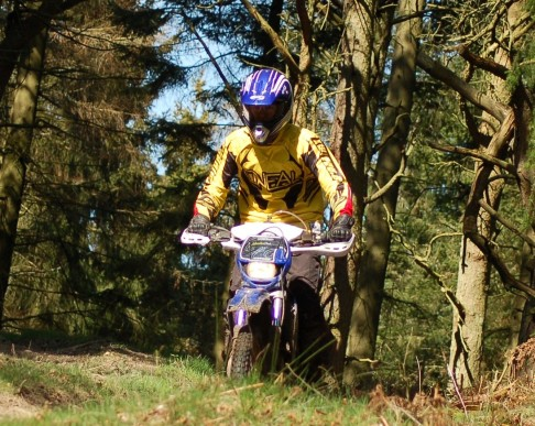 Chiz demonstrates his fluid riding style through Hopton Woods. Typical teenager, going out without a proper jacket on...