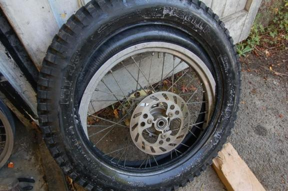 Once both sides of the tyre are free from the rim the rim and tyre will drop down into the tyre.
