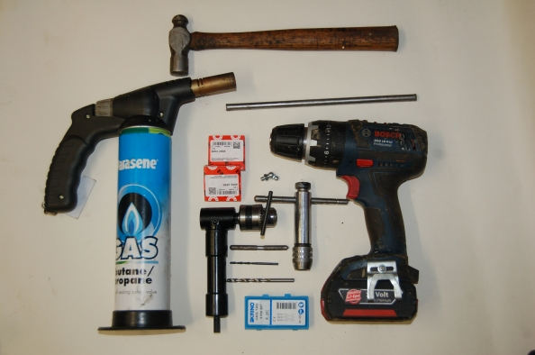 9] This is the kit I used, hammer , drift, centre punch, 2mm pilot, 5mm drill, 6mm tap set, tap wrench, blow torch, drill, 90 degree drill adaptor , nipple and a couple of bearings. I bought everything off eBay, the taps drills and nipples were a few pounds, the only expensive thing being the 90 degree drill adaptor at thirteen quid.